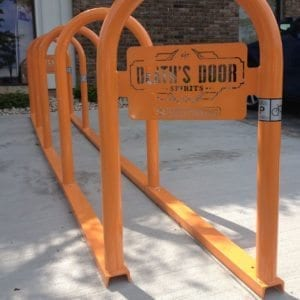 outdoor parking_angled stadium rack_with custom plate_outside